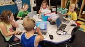 1st Grade students working on Chromebooks