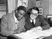 Jackie Robinson signing a contract with Branch Rickey