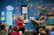 Hillary reading to children