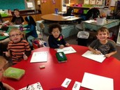 Singing and writing Word Wall Words.