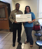 Ms. Addison received a check from the Horace Mann Company for her charity.