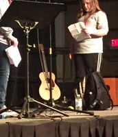 Emma participating in a drama during Worship!