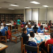 AVID students working hard at our Library!