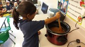 Riley stirring our cooked apples..