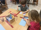 Making lines with rulers and cutting them!