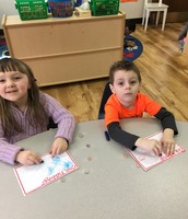 Savanna and Michael doing coin rubbings