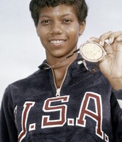 ( Wilma Ruldolph with gold medal )