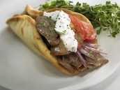 A tasty looking food called a Gyro!