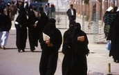 Islams Walking Down Street