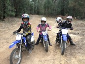 My children (plus one) on their motorbikes