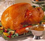 We always have a huge turkey with home made gravy and stuffing