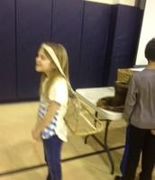Eliza with a head basket.