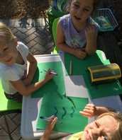Mila, Ryan, and Olivia sketching a worm that Mila shared with us