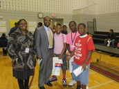 Principal Perkins, TLI Team, & DMS Students at Rotating Through Literacy Stations