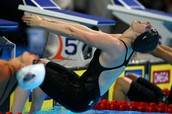 Missy Franklin pushes off of the block at the start of the 100 meter backstroke event for women