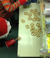 "Santa Pirates hooking pretzels with their ""hooks"""