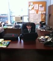 Behind the Desk