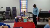 Nan methodically choosing her gift!