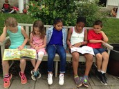 We love reading outside with our buddies