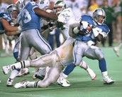 Barry sanders breaks a tackle against the Philadelphia eagles