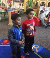 Rithik and Shaan practice the nursery rhyme of the day.
