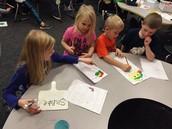 2nd graders helping kindergarten students