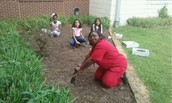 Ms. Lopez Digs in the Dirt