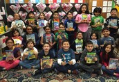 Ms. Barrett's 2nd grade Panthers show off their new books that were donated for I Love Reading Day!