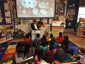 One of our amazing Pillow volunteers reads a story to Ms. Kyler's PreK class!