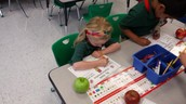 Fiona is identifying the color of her apple!