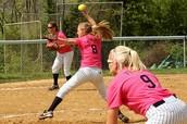 Female Baseball Team Playing Softball