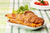 Heavenly golden ham and cheese croissant