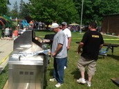 PTO Dads grilling hot dogs and hamburgers for lunch. Yum!
