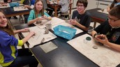 6th graders working on clay