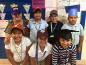 Fourth grade also wore their caps