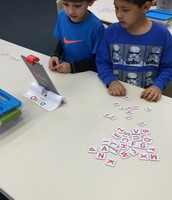 Ben and Dustin are working hard at a math game!