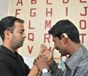 How many organizations help Deaf-blind people around the world?