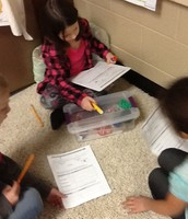 A variety of items are measured using centimeter cubes.
