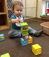 Watch and see how high I can stack these blocks!