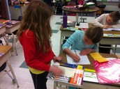 Davis and Thea work together to write their article.