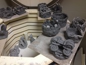Clay gargoyles and coil pots waiting to be fired - Grade 5