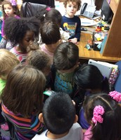 Kinder Following Clues to Find the Gingerbread Man!!