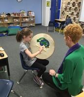 Mrs. Crain teaching us how to play the Irish bodhran drum
