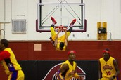 Harlem Wizards Hanging from the basketball hoop!