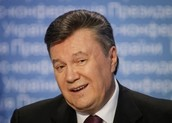 Who is President Yanukovych, and why has he fled?