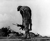 A man carries wounded comrade.