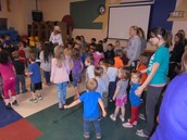 Dancing with Ms. Isabel from Room 5