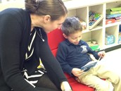 Mason reading to Mrs. Rauch