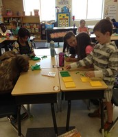 Working together in math with base ten resources