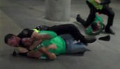 Policeman puts Person in Choke hold